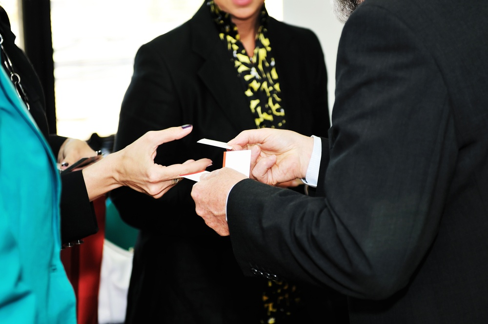 business people group change business cards on meeting seminar or conference