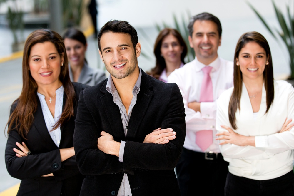 Successful business group looking confident and smiling.jpeg